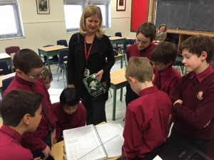 Students at St. Michael's Choir School examine Parry's full orchestral score.